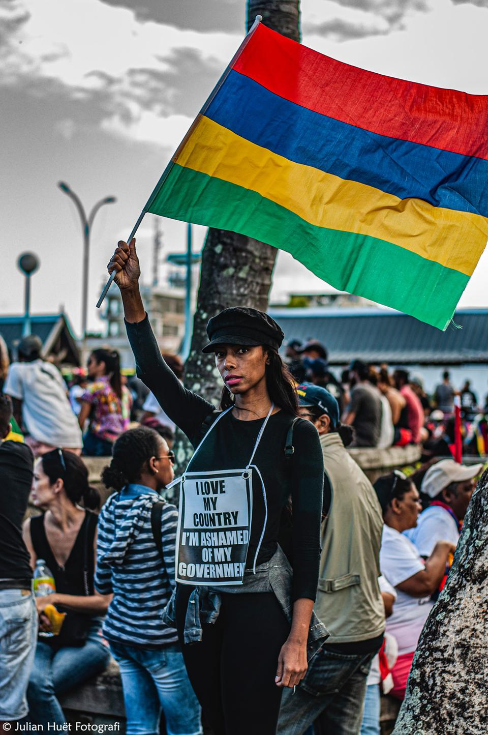 12 Sep 2020: protester in Mahebourg, Mauritius wearing a sign that says 'I love my country. I'm ashamed of my Government.'