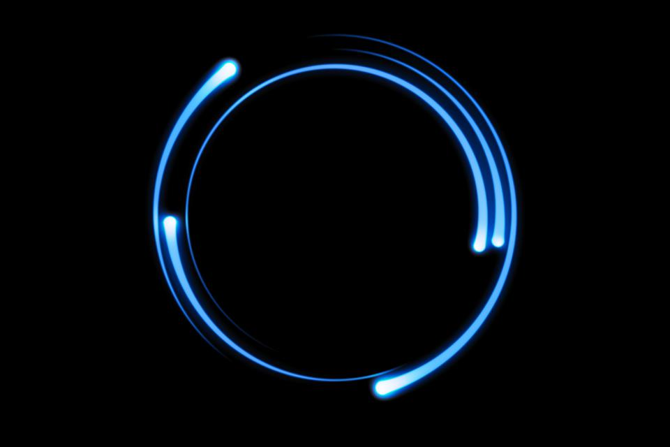 Blue fire comet light flying in circle. Shining lights in motion with particles on black sky. Ring of fire, abstract background