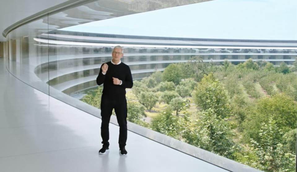 Tim Cook in hallway of Apple headquarters in Cupertino
