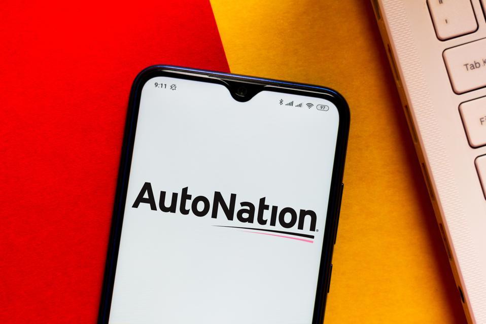 In this photo illustration the AutoNation logo seen...
