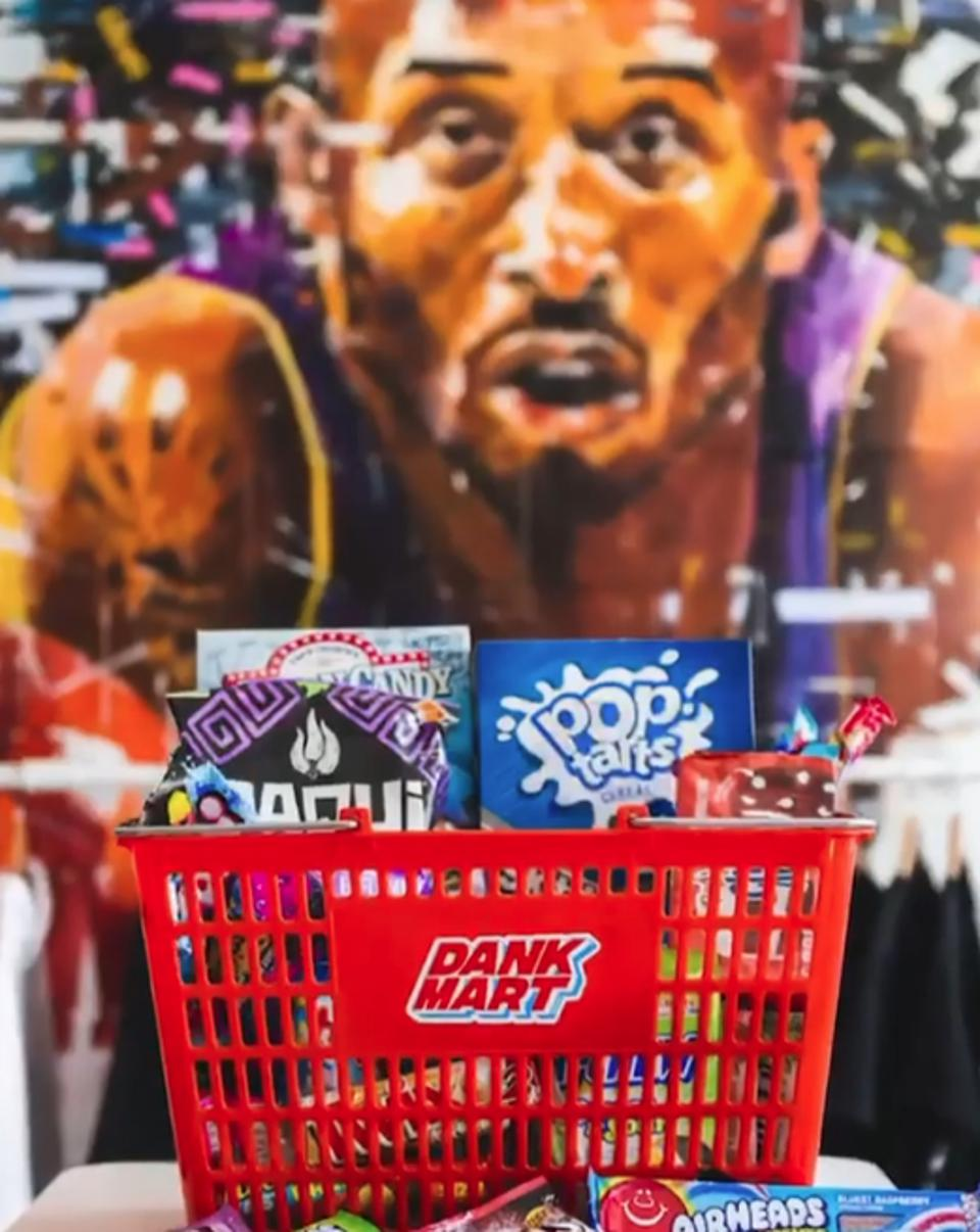 A selection of snacks available at Dank Mart, pictured in front of a Kobe Bryant mural.