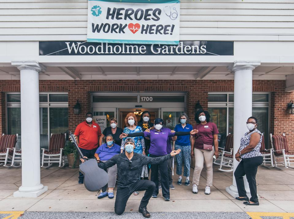 Franky Perez with care workers at Woodholme Gardens