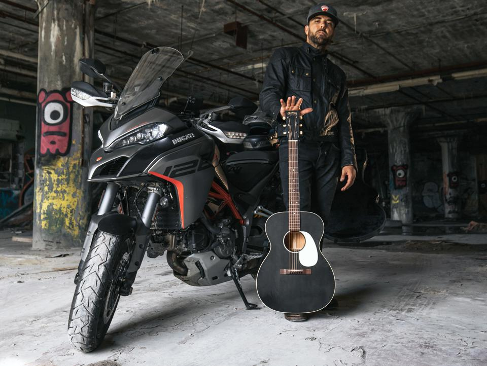 Franky Perez with Ducati motorcycle and Martin guitar