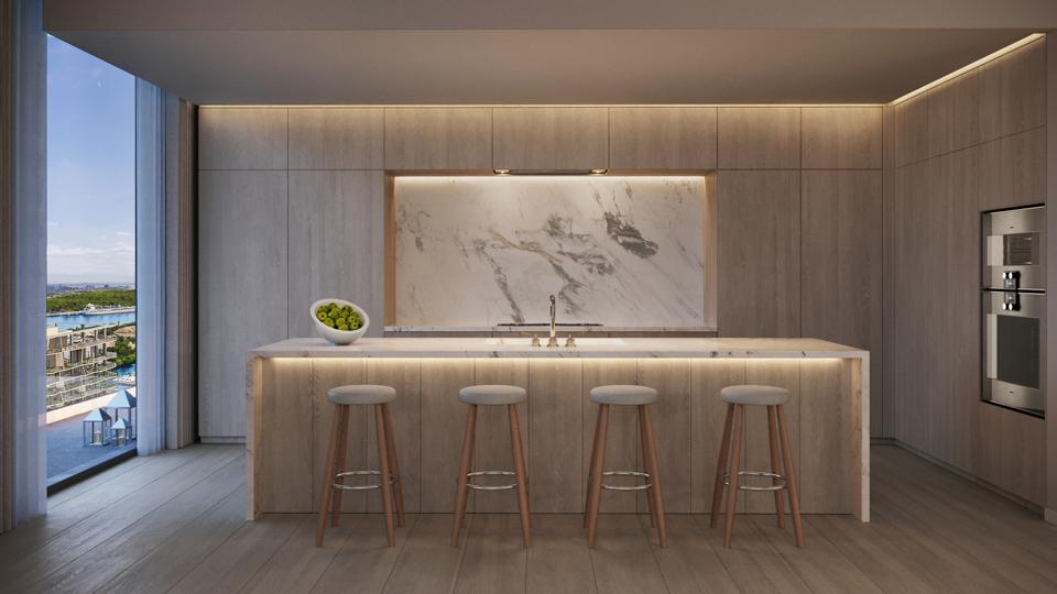 A neutral kitchen in a modern, minimalist style with great views.