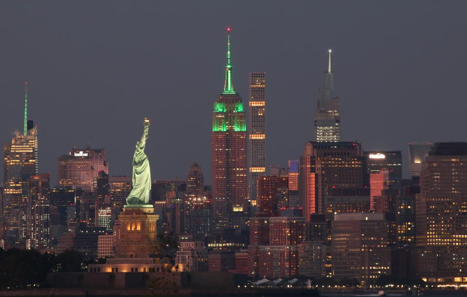 Sunset in New York City, with the Empire State Building lit up in green for Climate Week.