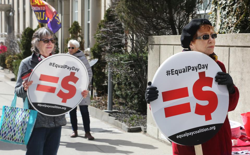 Women Rally On 'Equal Pay Day' In Toronto