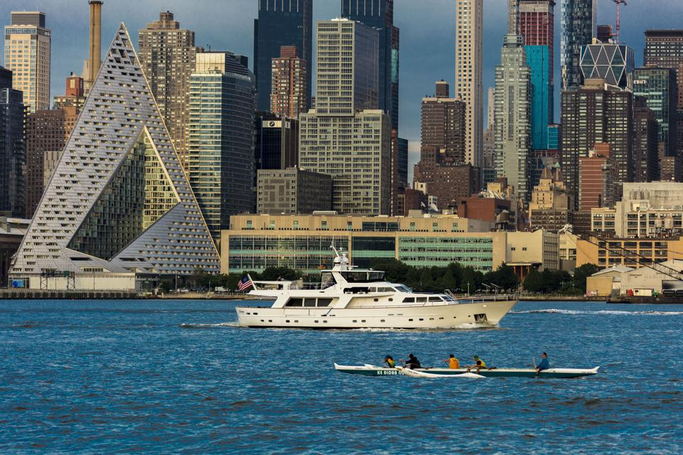 New York City and Hudson River features VIA 57 Building Pyramid shaped building by Bjarke Ingels, and Manhattan Skyline