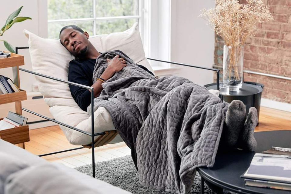Man sleeping with grey Gravity Blanket weighted blanket