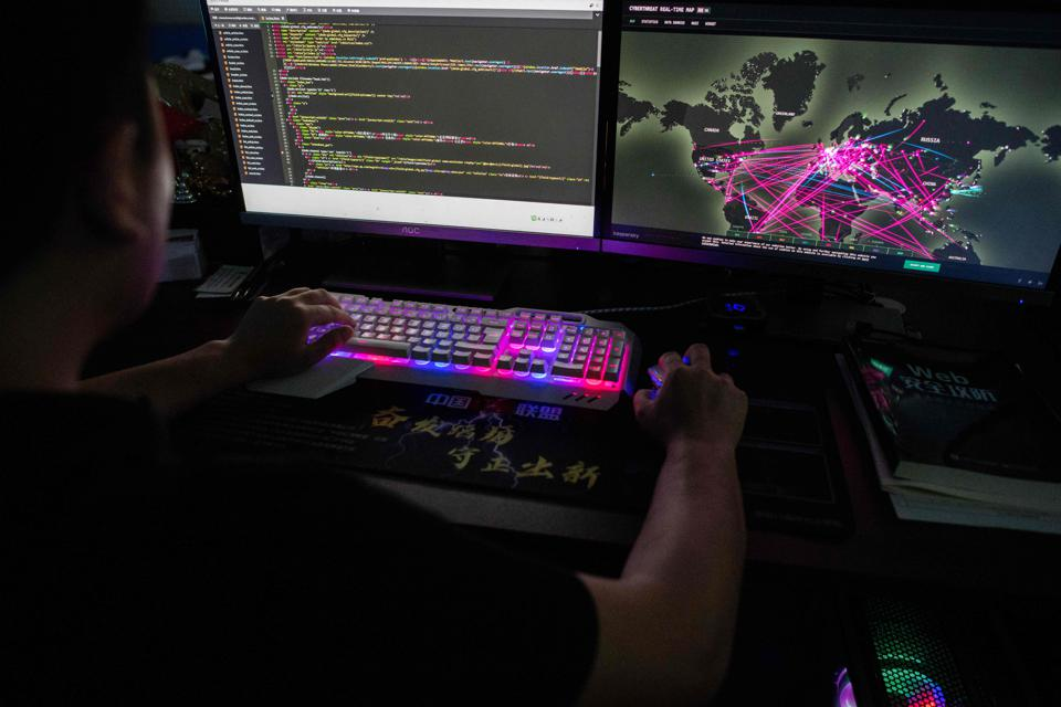 Chinese cyber hacker working