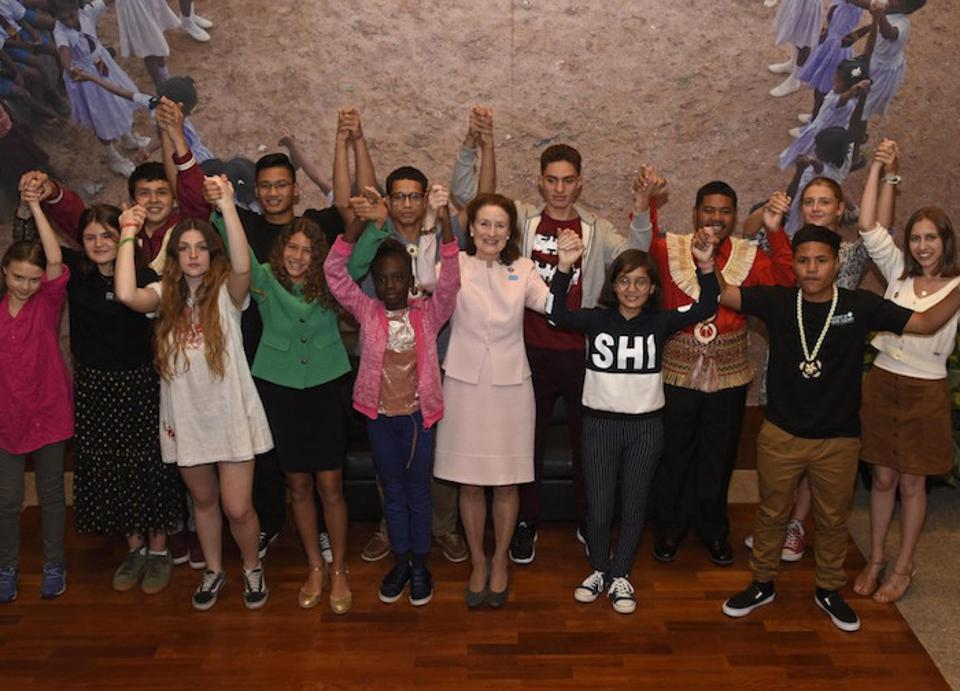 UNICEF Executive Director Henrietta Fore joins hands with youth climate activists before sitting down for a discussion at UNICEF House in New York City on September 23, 2019.