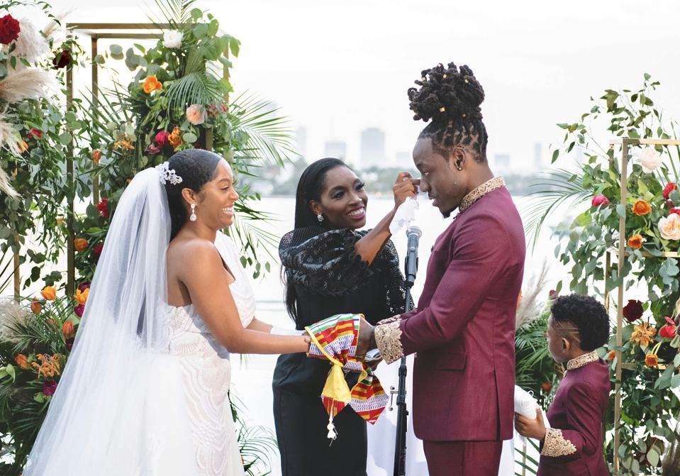 Rev. Roxy Birchfield with celebrities Ace Hood & The Shelah Marie at the wedding alter.