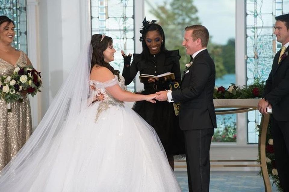 Rev. Roxy conducting the wedding ceremony for a couple at the Disney World Wedding Pavilion.