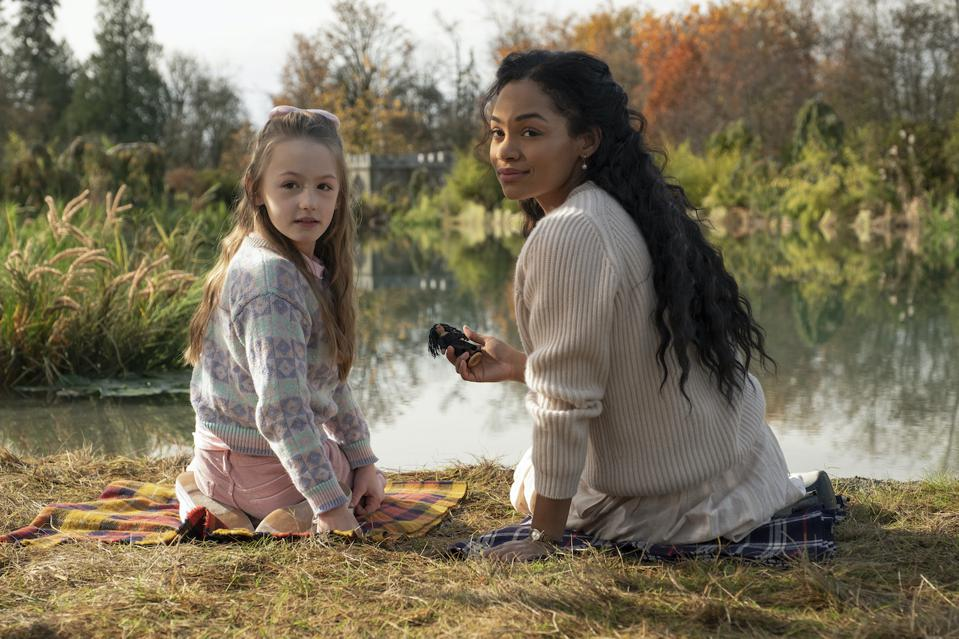 Amelie Smith as Flora and Tahirah Sharif as Rebecca Jessel in 'The Haunting of Bly Manor' which premieres October 9 on Netflix.