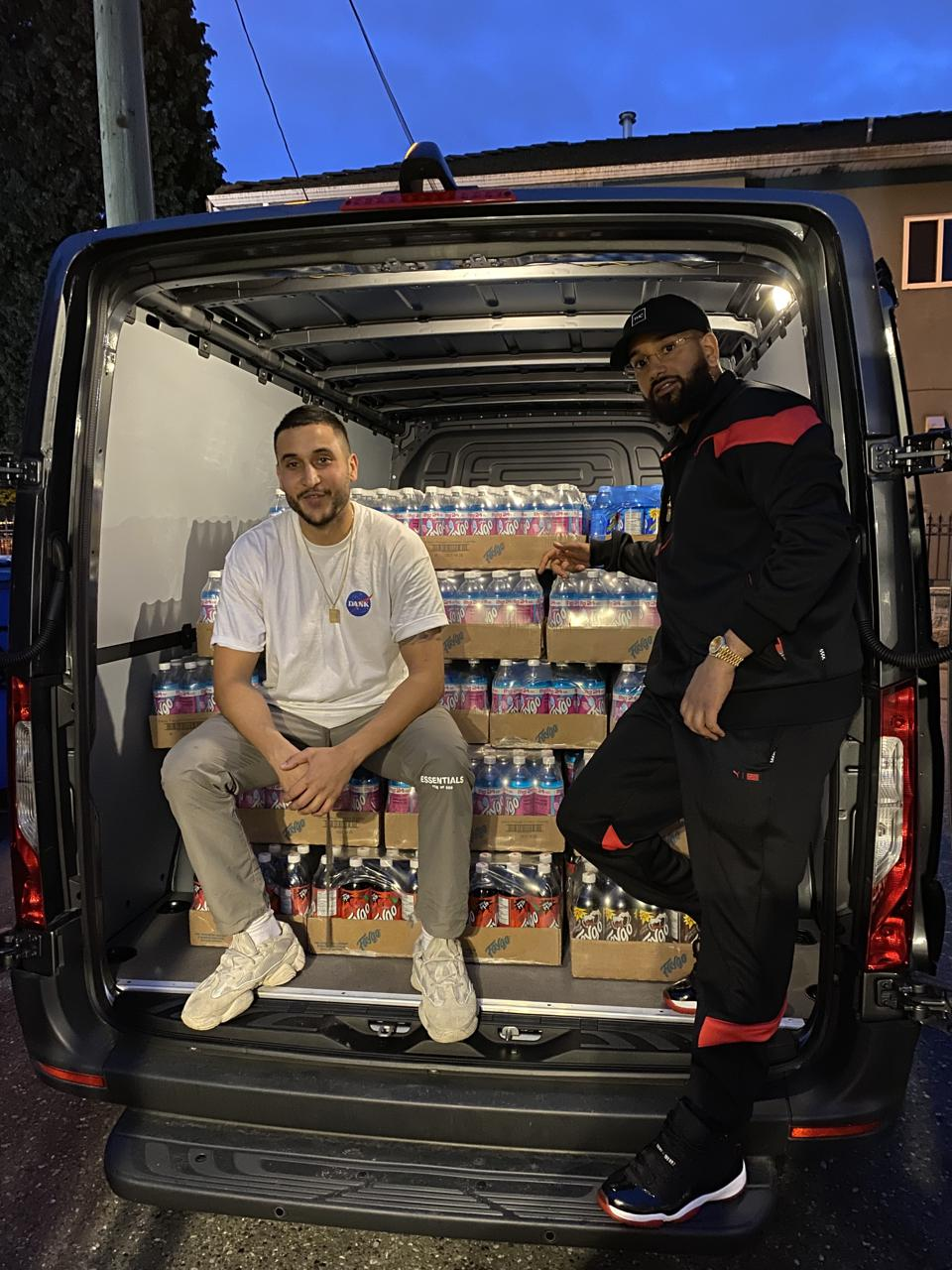 Shakur, left, and Sangara, right, in a van loaded with a fresh delivery for Dank Mart.