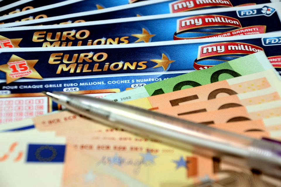In this photo illustration a pen and euros banknotes on...