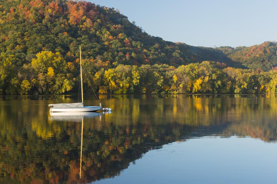 Lake Winona In Autumn with single sailboat