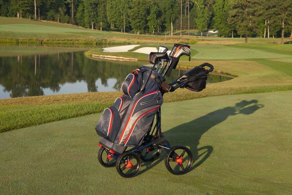 golf bag resting on a push cart