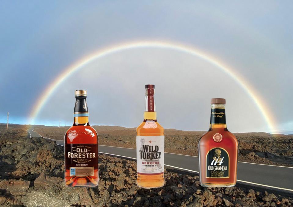 Three bottles of reasonably-priced bourbon under a rainbow on Moana Loa volcano
