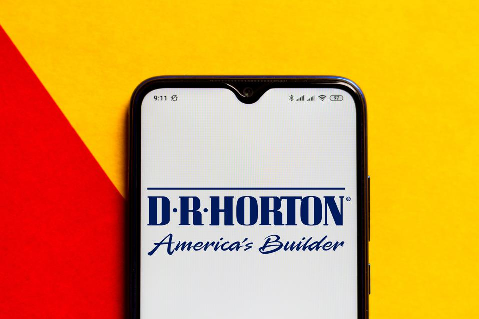 In this photo illustration the D.R. Horton logo seen...