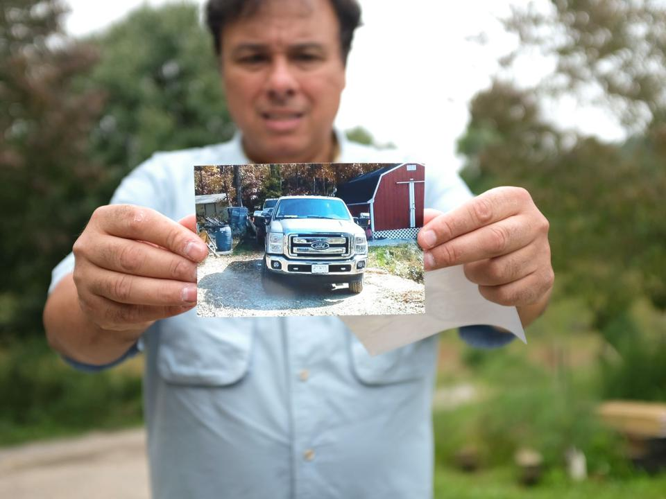 man holding photo of truck