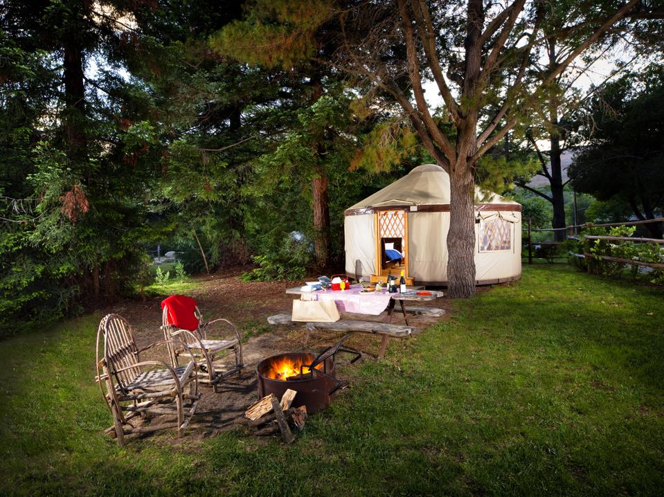 Outdoors chairs and fire by yurt