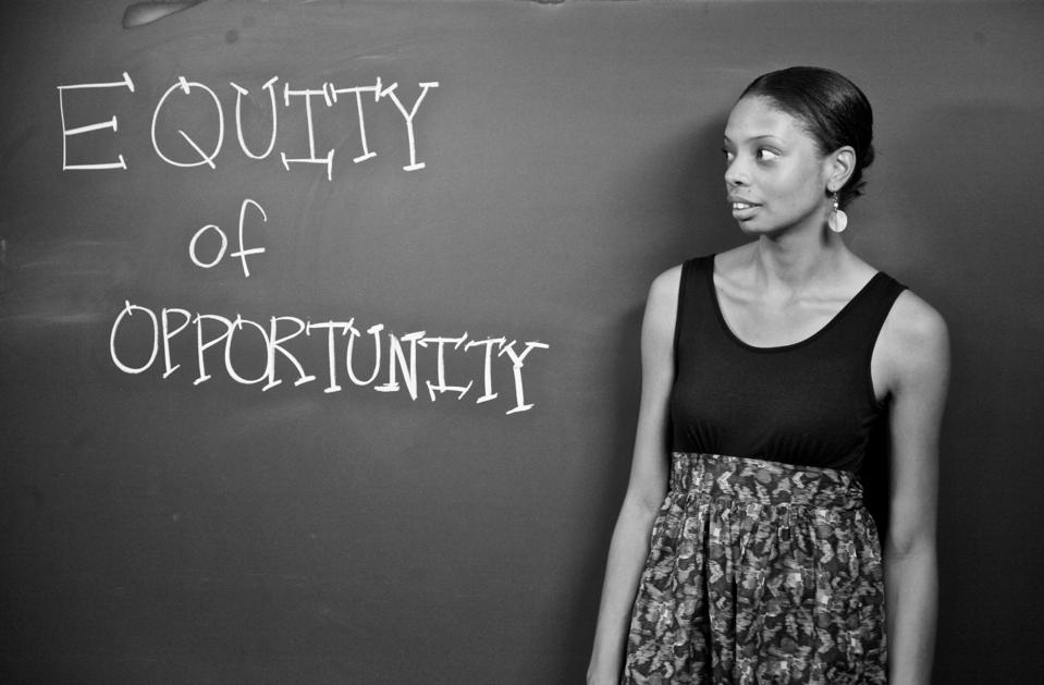 Danielle Allen stands in front of a chalkboard that reads ″Equality of Opportunity″