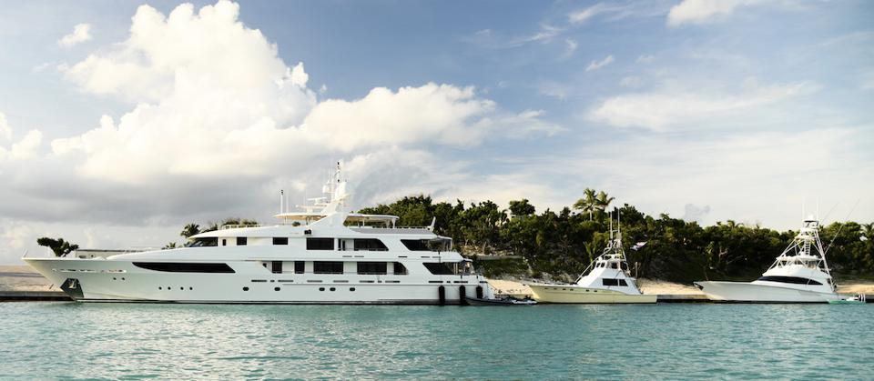 Carl Allen's armada docked at the newly redeveloped superyacht marina at Walker's Cay.