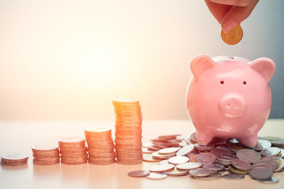 Hand Saving Money concept, Piggy bank with coin for Wealth Income and Profit Financial Business Grow