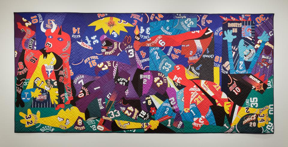 Hank Willis Thomas (American, born 1976), 'Guernica,' 2016. Mixed media, including sport jerseys, 131 × 281 inches. Private Collection.