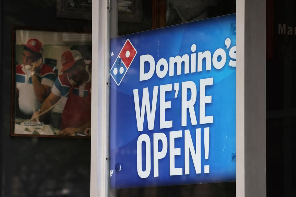 Sign on window of Domino's store in Brooklyn.