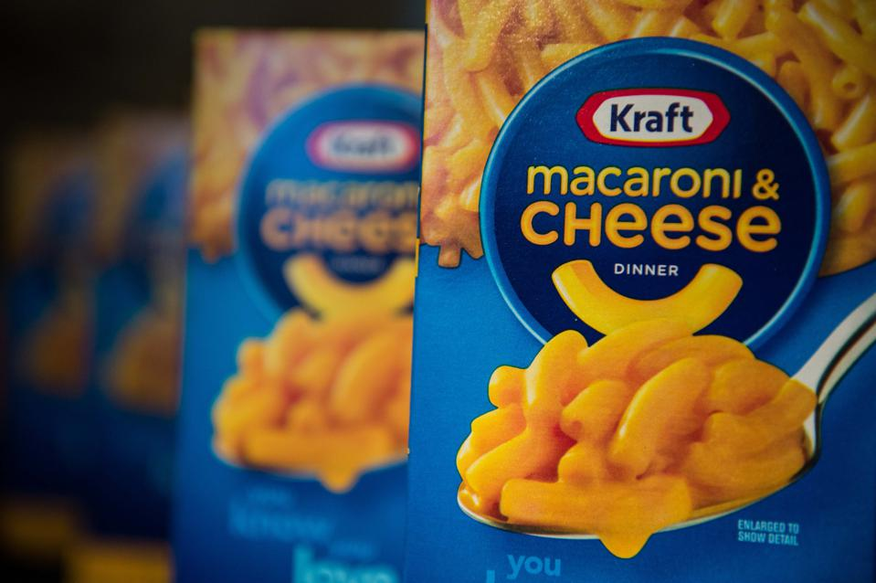 Kraft Macaroni & Cheese packages on shelf.