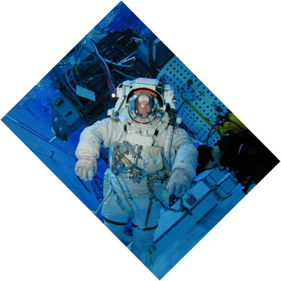 Tony Uttley in a spacesuit submerged inside NASA's Neutral Buoyancy Laboratory where astronauts are trained to do spacewalks