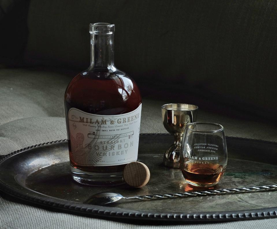 Bottle of bourbon and glass on a tray