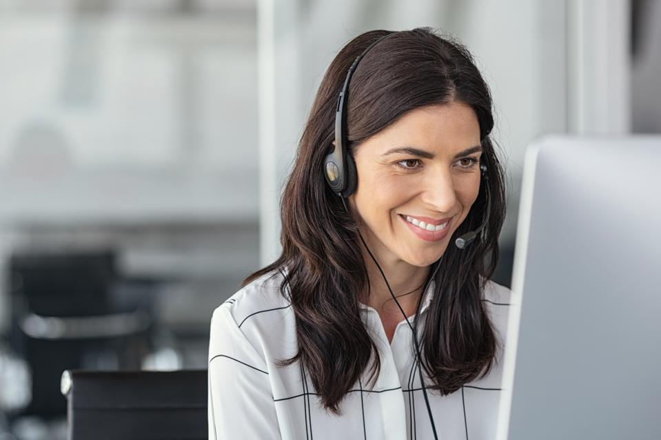 Smiling latin woman in call center