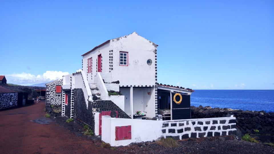 The houses in Cabrito in Pico are made of lava and clay with red doors and windows.