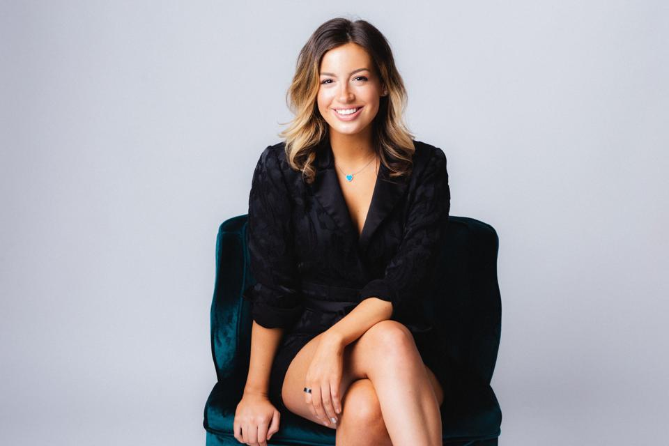 Haley Hoffman Smith wearing black dress sitting on chair