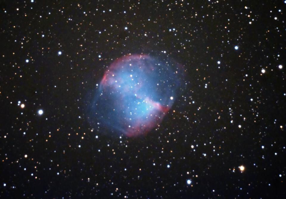 The Dumbbell Nebula shines brightly, and was the first planetary nebula ever discovered.