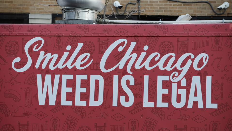 A red sign with white text that reads Smile Chicago Weed is Legal.