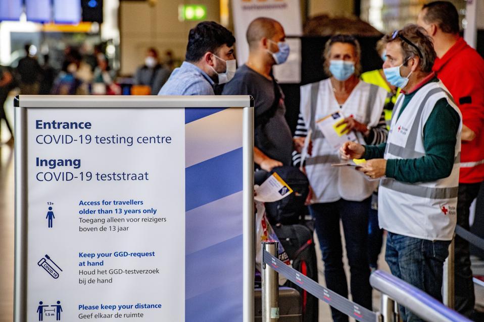 Travelers face masks quarantine COVID-19 testing travel airlines
