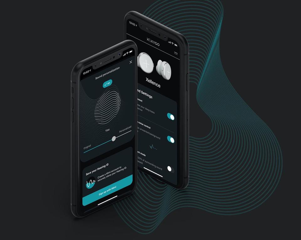 Two smartphones showing the X by Kygo app