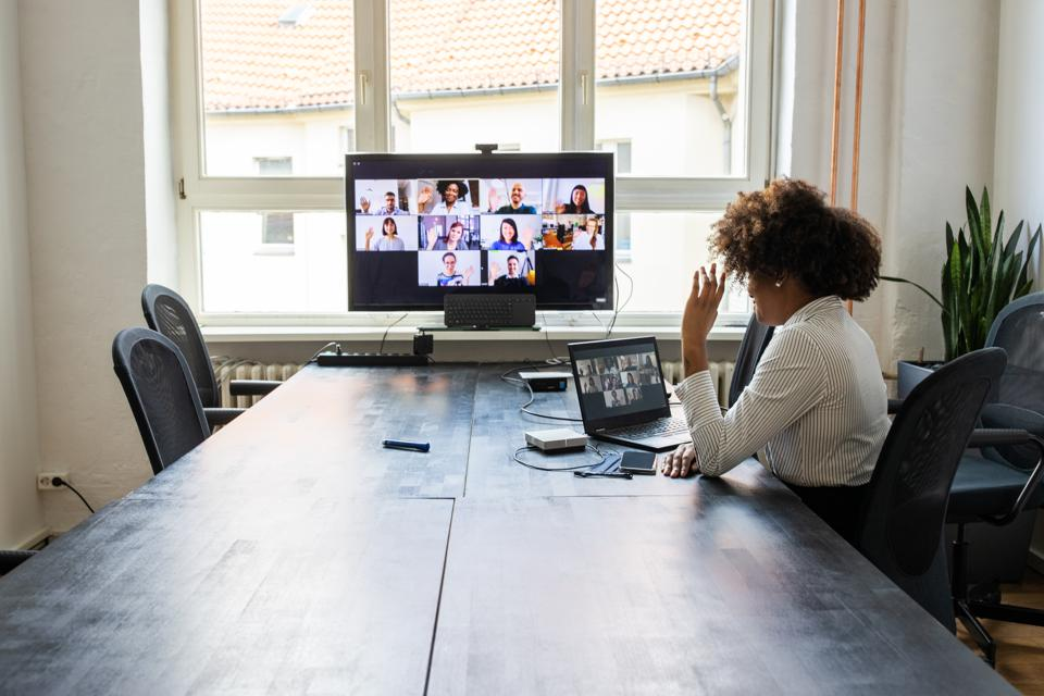 Meeting over a video call in office post pandemic