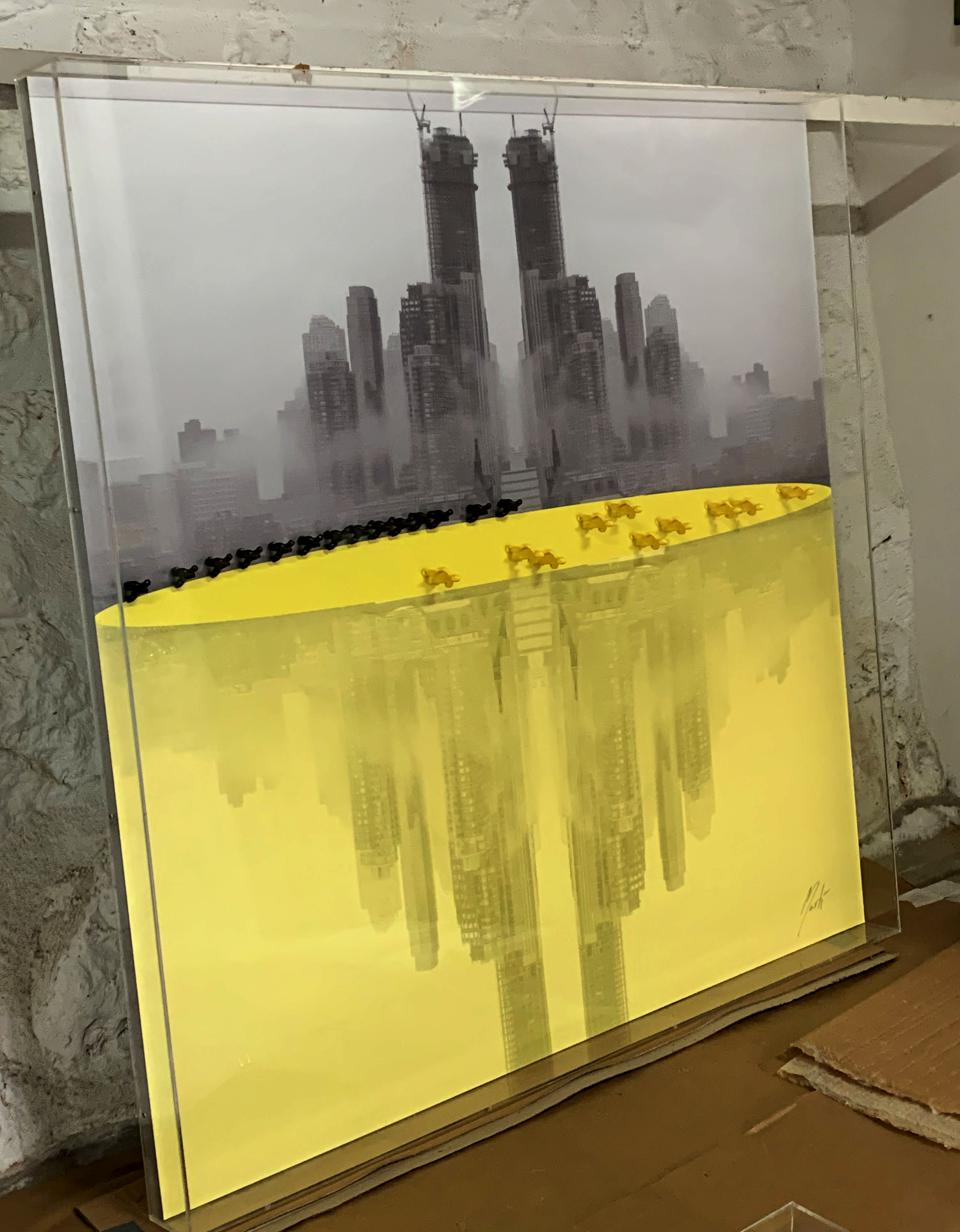 An installation of believers in New York which reflects New York in bright yellow.