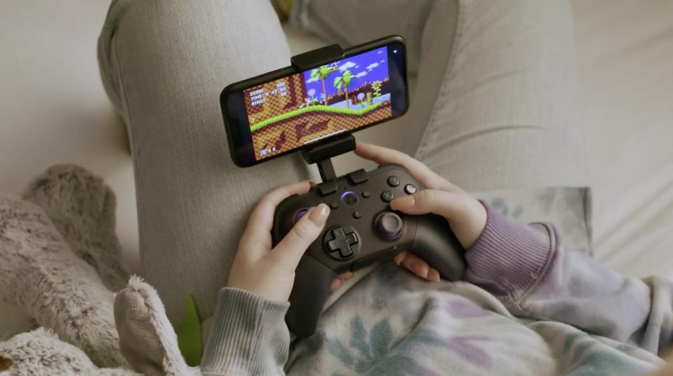 Amazon's new game controller with iPhone in someone's lap playing Sonic
