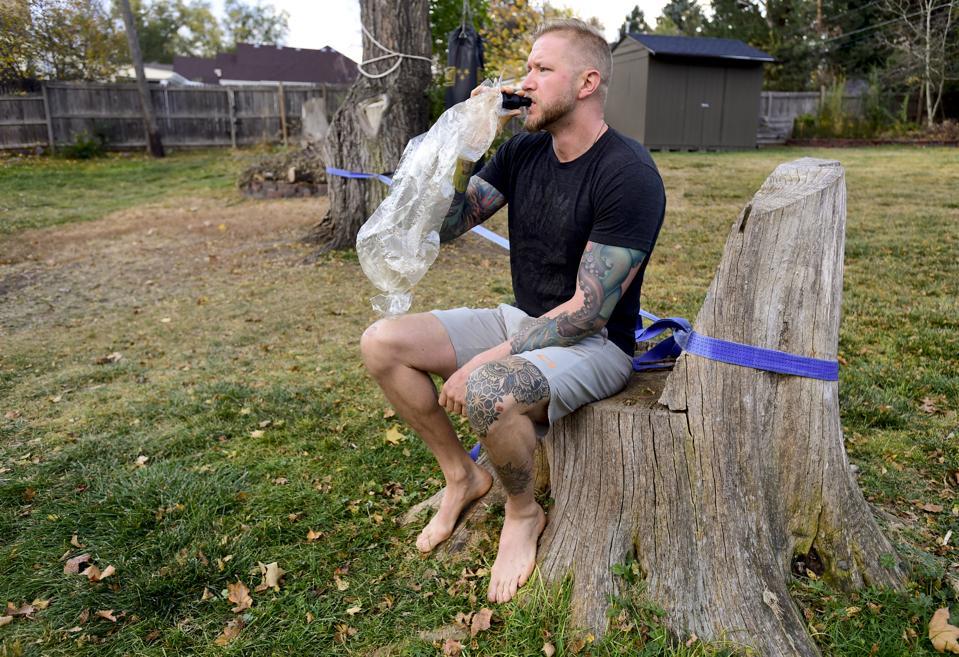 Veteran Curt Bean vapes marijuana while in his backyard.
