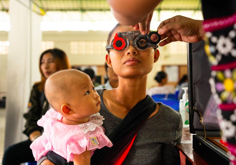 OneSight patient receiving an eye exam in Thailand.