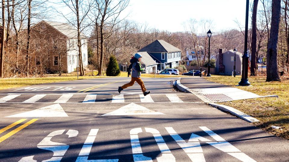 Child running on crosswalk