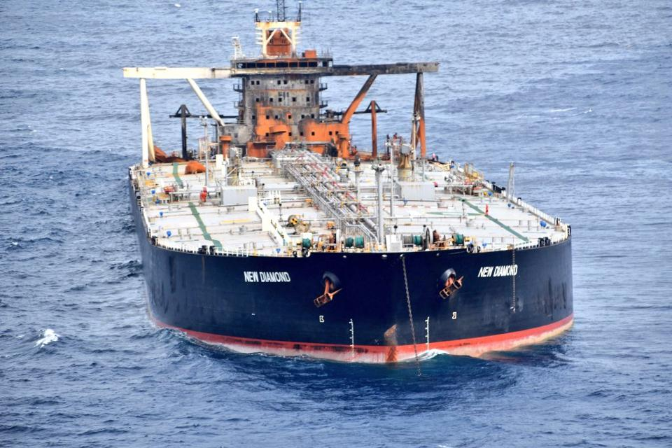 The burnt structure of the oil supertanker, MT New Diamond, now being towed along the coast of India.  The vessel is carrying 2 million barrels of oil and suffered an explosion that killed a crew member.