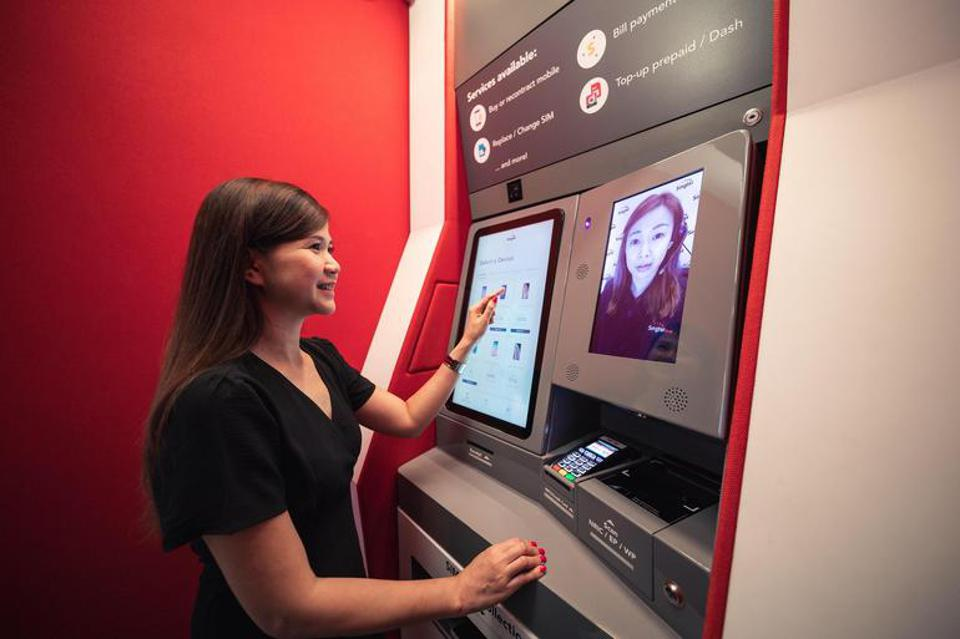 Consumers can interact with staff and carry out services through the store's video-assisted self-service kiosks.