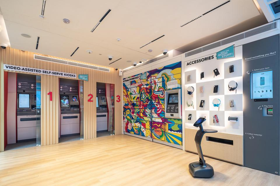 The pop-up store offers a variety of services, supported by a live roving robot and video-assisted kiosks as interaction points.