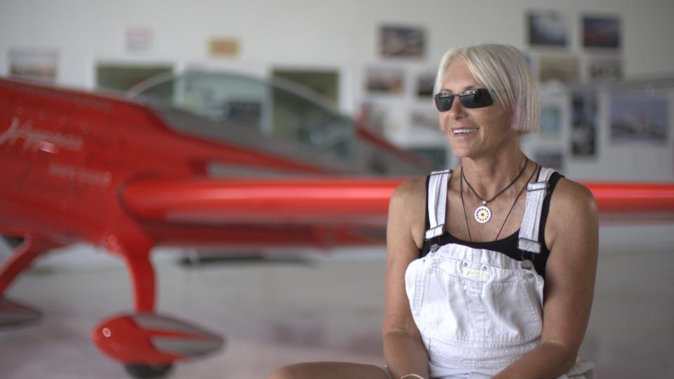 Patty Wagstaff sits for her interview in from of an airplane